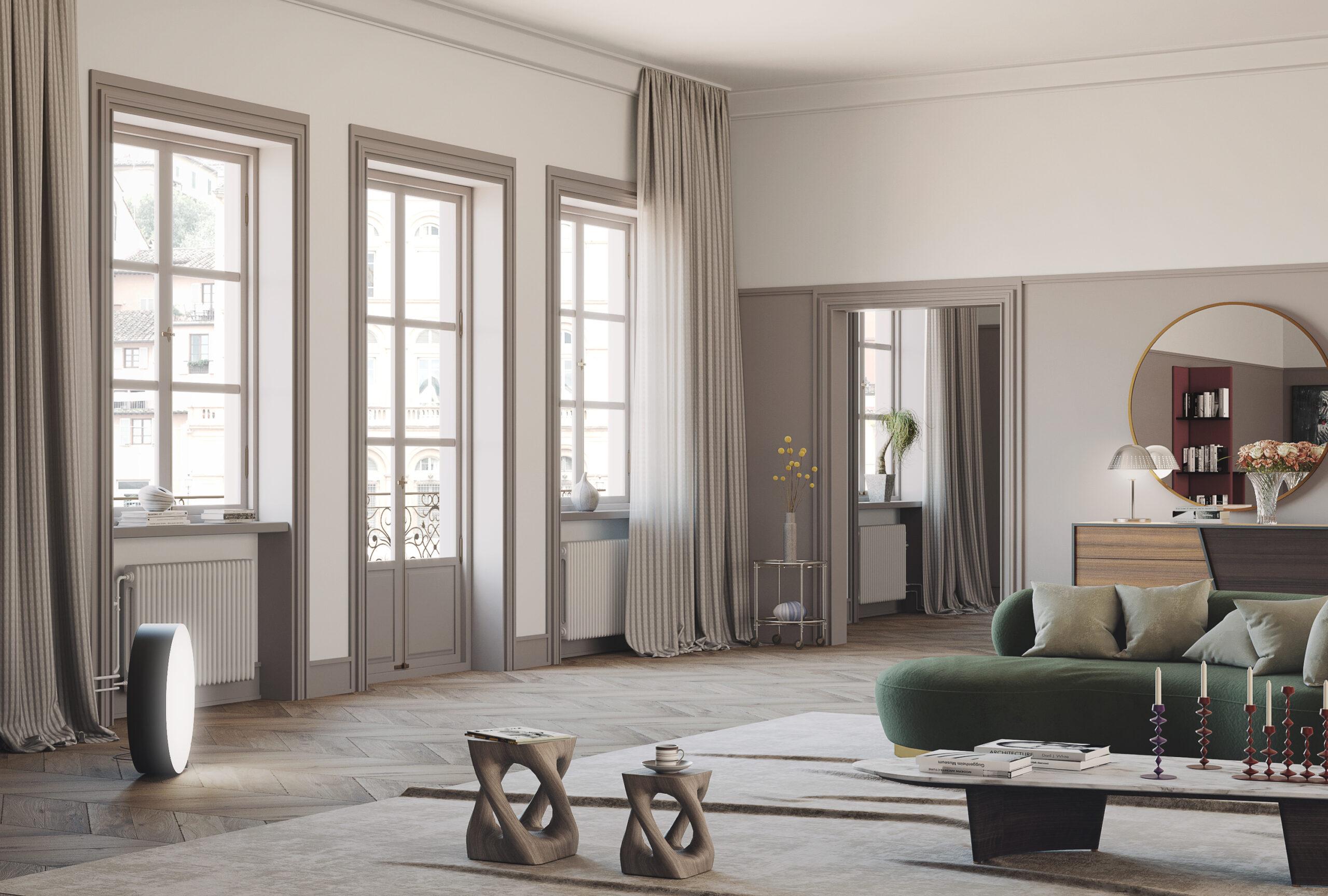 Salone color cipria con finestre e divano verde